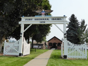 A 3/4 replica of the Fort Sherman entrance with the Powder House behind.
