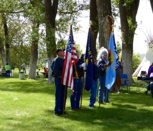 Color guard featuring the US Flag, Montana Flag, Crow Tribal Flag and Chief Plenty Coups Flag, authorized by the US.