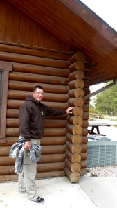 Randy, the engineer, trying to figure out how corners of log cabins are put together.